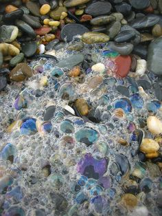 bubble portrait by *omnia* (flickr) #reflections #colors #bubbles #stones #rocks #beach #sea #photography
