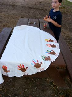 Hand print turkey tablecloth. Have your kids add a new hand print every year or get all the little cousins together to make a special tablecloth for the grandparents.