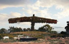 What Famous Landmarks Would Look Like After A Global Disaster digital paintings by John Walters and Peter Baustaedter, inspired by The Last of Us video game.  The Angel of North, designed by Antony Gormley, finished in 1998, Gateshead, UK