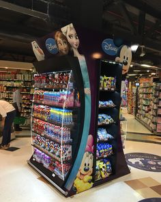 Disney floor stand with products on Behance