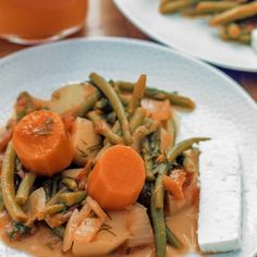 Green bean stew with carrots and feta