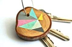 Wood keychain with stainless steel cable wire, tones of baby pink, blue, grey, yellow, mint geometric triangle shapes