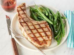 Grilled Pork Chops : There's no need for a marinade or glaze to complete Ina's thick-cut pork chops — just salt, pepper and smoke from a charcoal grill.