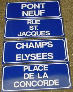 french street signs above the sofa