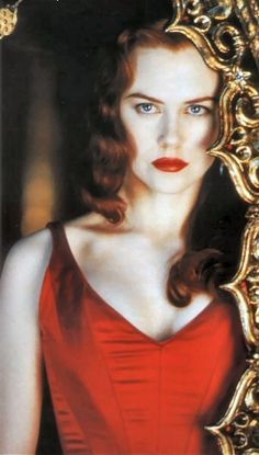 [b]Film:[/b] Moulin Rouge [b]Character:[/b] Satine [b]Played by:[/b] Nicole Kidman This red satin gown was worn during the elephant love medley scene . Nicole Kidman Moulin Rouge, Satine Moulin Rouge, Moulin Rouge Movie, Rocky Horror, Tom Cruise, Rouge Makeup, Divas, Short Red Hair, Beautiful Red Hair