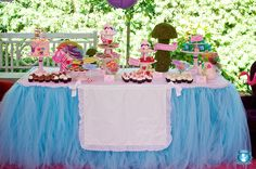 Welcome to Wonderland! A sweets and treats station was the centerpiece of this Alice in Wonderland-themed birthday for an adorable 4 year old. A custom table tutu and pinafore—made to look like Alice's iconic dress—made the table extra special. Source: Sweets Indeed