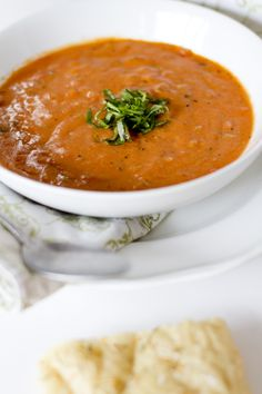 Creamy Tomato Basil Soup with Parmesan  Ingredients 28 oz. can crushed tomatoes 1 cup finely diced onions 1 cup finely diced carrots 1 cup finely diced celery ¼ cup vegetable oil 4 cups chicken broth 1 tbs. dried basil 1 tsp. dried oregano 1 bay leaf ½ cup flour ½ cup butter 1 cup Parmesan cheese 2 cups half and half salt and pepper