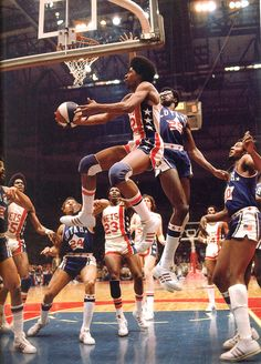 Julius Erving aka Dr. J - the best basketball player I have ever seen play. Think I remember 4 out of the 5 NY Nets in this picture. Larry Kenon, John Williamson, Billy Paultz and, of course, the Doctor. The one to the right of Dr. J in this picture is unknown to me. Maybe Sonny Dove or Brian Taylor