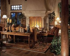 Elegant tuscan decorating | Warm & elegant. My favorite is the fireplace with a large opening! What a statement!!