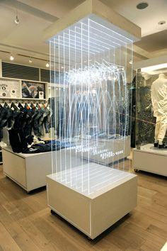 © denham - premium denim arrives at omotesando hills. Edge lighted engraved images in acrylic