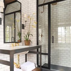 Everything about this bathroom makes me smile. Wish i knew the owner of this photo??? Subway tile - gooseneck shower head - industrial