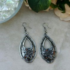 ♠Rose detailed dangle earrings w/ rhinestones Beautiful dangle earrings with rose design & brown stones!! Wear these with a special outfit or wear them just for casual every day wear!! You can't go wrong!! Lead & nickel free. Nwot  Price firm unless bundled Jewelry Earrings