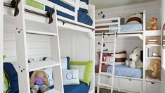 A spacious Gulf-front house in Seaside, Florida, is a favorite destination for an extended Louisiana family, and this fun and practical bunk room helps accommodate the younger generation. Library-style rolling ladders and bright bedding add the perfect do