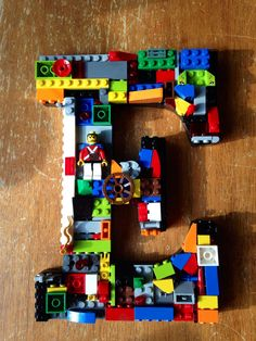 This is a LEGO (r) mosiac name Ezra. It is a sample of what I can create. It is made with 100% genuine LEGO(r) pieces. The letters are 9 inches high and come in white or black. Each name comes with one minifigure. Contact me for custom orders. 'LEGO® and the Brick and Knob configurations are trademarks of the LEGO Group of Companies which does not sponsor, authorize or endorse this product
