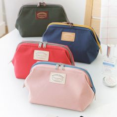 487a5d9d09 Iconic Multi double zipper frame pouch cosmetic bag