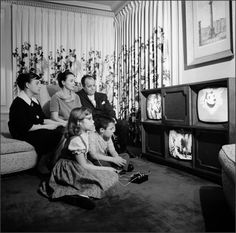 """Three Screen Television 1961  """"In 1961,Chicago TV pioneerUlises Sanabriatested the market for athree-screen televisionwith a photo spread in LIFE magazine. I suppose the advantage it had over simply owning three individual TVs in different rooms of the house is that it kept the family together – at least, physically. A hi-fi record player is concealed behind the center speaker panel."""""""