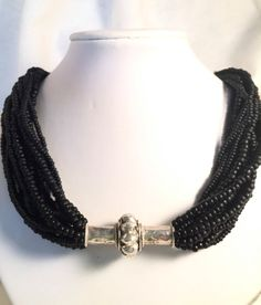 Multi-strand black seed bead necklace with antique silver pendant, Statement necklace, Antique pendant, Seed bead necklace, Career necklace by nancyandersondesigns on Etsy Seed Bead Necklace, Seed Beads, Arrow Necklace, Beaded Necklace, Black Seed, Antique Silver, Handmade Items, Career, Etsy Shop