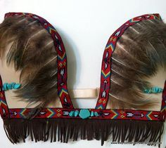 *****LAST WEEK ON SALE***** Show your sexy side with a deep plundging Native American rave bra! Lined with feathers & fringe it's perfect for your next event ! (NEED MATCHING BOTTOMS?) CHECK OUT MY OUTFITS FOR MORE OPTIONS! |ADD YOUR BRA SIZE IN NOTES BOX DURING CHECKOUT| ! ALL ITEMS ARE MADE BY HAND & MADE TO ...