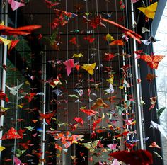 Paper Crane Strings! If you have 1000 handmade paper cranes at your wedding it's supposed to be good luck! :))