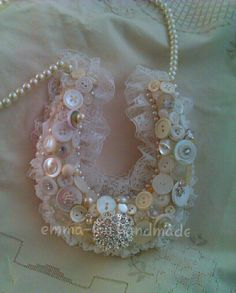 Vintage buttons were used for this Bridal Horseshoe. Given to a Bride for Good Luck .