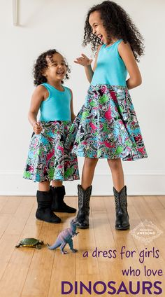 Description: T-Rex, Stegosaurus, and Triceratops romp around volcanoes, hatching dino eggs, and other prehistoric elements in this brightly-colored future-paleontologist's dream dress with deep pockets and a big full twirly skirt. 100% cotton.  Made in the USA. Sizes 2T-12.