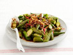 Wok-Fired Okra Sambal : Okra is a Southern staple, but here it gets a kick from a few Asian ingredients: chili paste, oyster sauce and fried shallots. You can buy fried shallots in tubs or jars at Asian markets, or just fry thinly sliced shallots in 350 degree F oil until crisp.