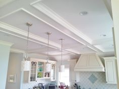 Coffered ceiling and crown. (Cabinets by Coastal Cabinets)