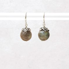 Captivating labradorite shines in shades of stormy gray and peacock blue, like a summer sky colliding with a thunderstorm. Each faceted bead...