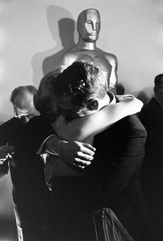 Joanne Woodward embraces husband Paul Newman after winning Best Actress at the 30th annual Academy Awards, photographed by Ralph Crane, 1958.