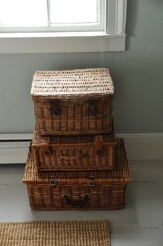 love this look of stacked picnic baskets, i only have two so far need more.