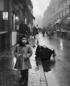 London, 1954 A young Jewish girl stands in a rainy street in Whitechapel in April 1954 Vintage London, Old London, London Kids, Victorian London, Jewish History, British History, Lyon, East End London, Jewish Girl