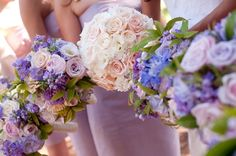<3 these. But Id switch the bouquets, so the bride and blues and purples and bridesmaids have light colors.