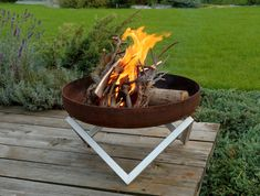 I like the geometric legs of this modern firepit. Would be nice for a small deck or patio.  Steel Fire Bowl YANARTAS Contemporary Design by ArpeStudio in London $197.11