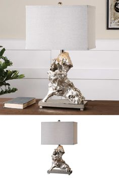 Faux driftwood finished in a metallic silver leaf accented with polished nickel plated details. The rectangle hardback shade is a light gray linen fabric with natural slubbing.