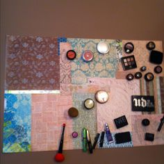 Makeup holder: Sheet of metal, coordinating scrapbook papers glued on top. Anchored to wall with screws. Hot glue magnets to makeup. Organize.