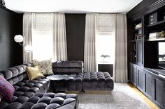 For the media room of this New York apartment, Fawn Galli had a tufted sectional custom built by Todd Merrill. The piece is designed to fit together and create a bed for overnight guests. The pillows are actually vintage dresses that Galli's firm repurposed, the floor lamp is a vintage 1960s Reggiani design and the custom rug is by Jan Kath.