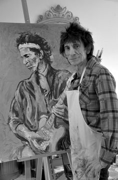 Musician Artist Ronnie Wood standing by his easel - another portrait, may not be Keith Richards. Carved Wood Wall Art, Wood Artwork, Rock And Roll Bands, Rock N Roll, Ronnie Wood Art, Rolling Stones Logo, Ron Woods, Celebrity Drawings, Keith Richards