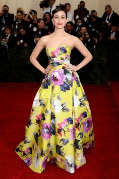 Met Gala 2014 Red Carpet. Emmy Rossum in Caroline Herrera. I've been digging the floral prints lately.