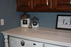 Building a counter OVER your laundry appliances, great storage solutions, especially in a tiny space.