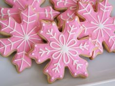 Christmas snowflake sugar cookie icing ideas...gorgeous pink and white icing with a dusting of glitter