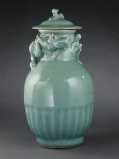 Chinese,Lidded Celadon Glazed Porcelain Funerary Urn (Lunghu Ping) with Dog and Dragon