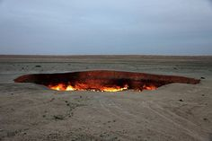 "Turkmenistan's ""Door To Hell""  In the middle of the Karakum Desert, this pitted, natural gas fire was ignited in 1971 by Soviet petrochemical scientists and has burned ever since. It is 70 metres in diameter and emits the smell of burning sulfur for miles."