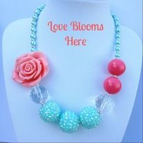 Coral turquoise girls chunky bead necklace. This+gorgeous+necklace+is+coral+with+light+turquoise+rhinestone+beads+and+pearl+light+turquoise+beads+up+the+side.+Sized+for+child+ages+1-7.  Facebook.com/lovebloomshere #lovebloomshere#chunkybeadnecklace #bubblegumnecklace #coralnecklace #girlsnecklace