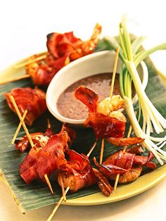 These bacon-wrapped shrimp are bushed with a sweet and spicy glaze. You may want to make a double batch of the appetizers--they're sure to go quickly.