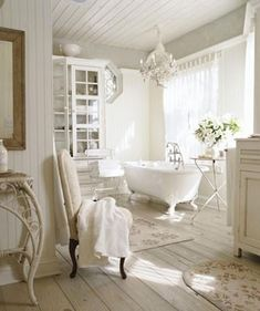 Awash in white and bathed in sunshine. This picture must be taken from the bed to be perfect.