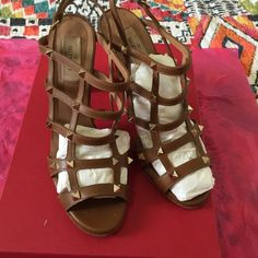Valentino Caged sandals Rockstud heels in brown. All studs are intact, some scratches on the leather, more on the heels. Some wear on sole. Euro size 39 1/2, please familiarize yourself with sizing. Only box is included. Valentino Shoes Sandals