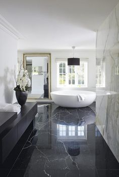 sexy bathroom white oval tub black marble floor orchids black modern vanity white marble walls large mirror luxurious