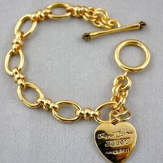 Juicy Couture bracelet  Gold JUICY bracelet. Worn but still in good condition! Feel free to make an offer! Juicy Couture Jewelry Bracelets