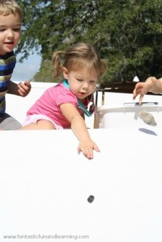 Painting with Rocks. Fun, creative outdoor activity!