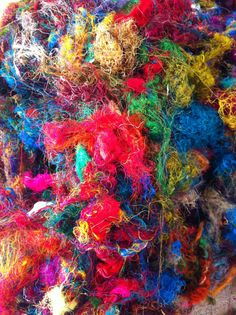 Multicolored sari silk waste. Magical vibrant colors. 200g. For spinning, roving, felting. Fibre art supplies.  Yarn Yarn on Etsy $24 for 200g.